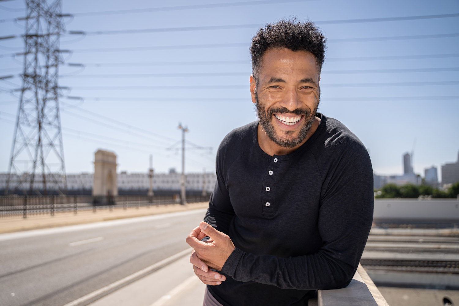 Lifestyle-On-Location-Model-Onmodel-Damion-Lloyd-Photography-Commercial-Product-Apparel-Clothing-Los-Angeles-Orange-County-male-man-GLYDER-sportswear-outdoor-city-black-shirt-buttons-smile-downtown