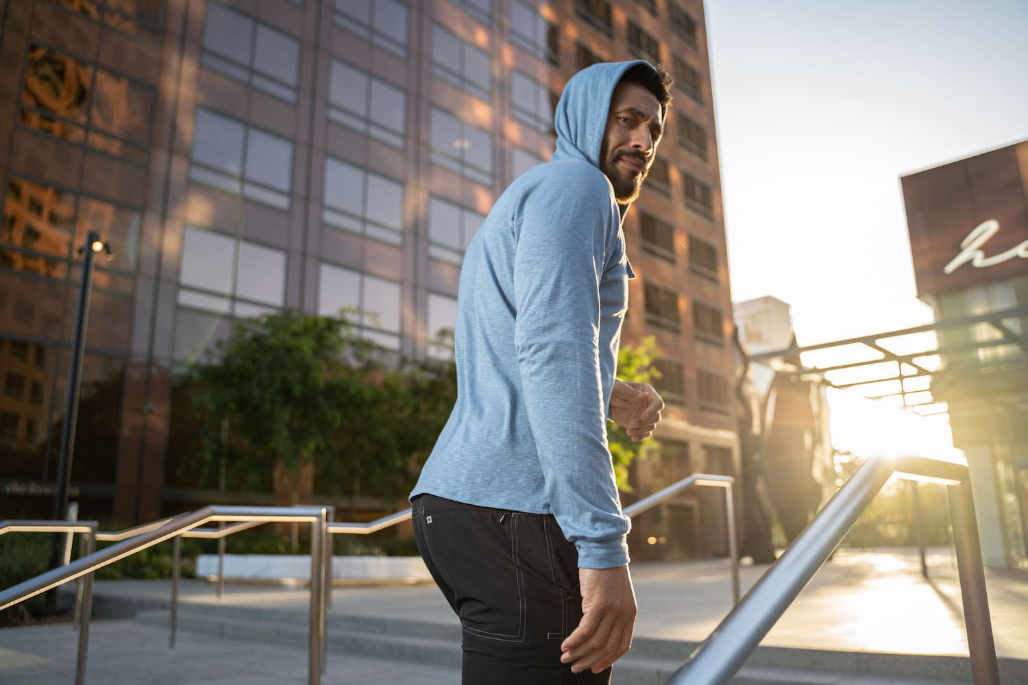 Lifestyle-On-Location-Model-Onmodel-Damion-Lloyd-Photography-Commercial-Product-Apparel-Clothing-Los-Angeles-Orange-County-male-man-GLYDER-sportswear-outdoor-city-blue-hoodie-sunset-back