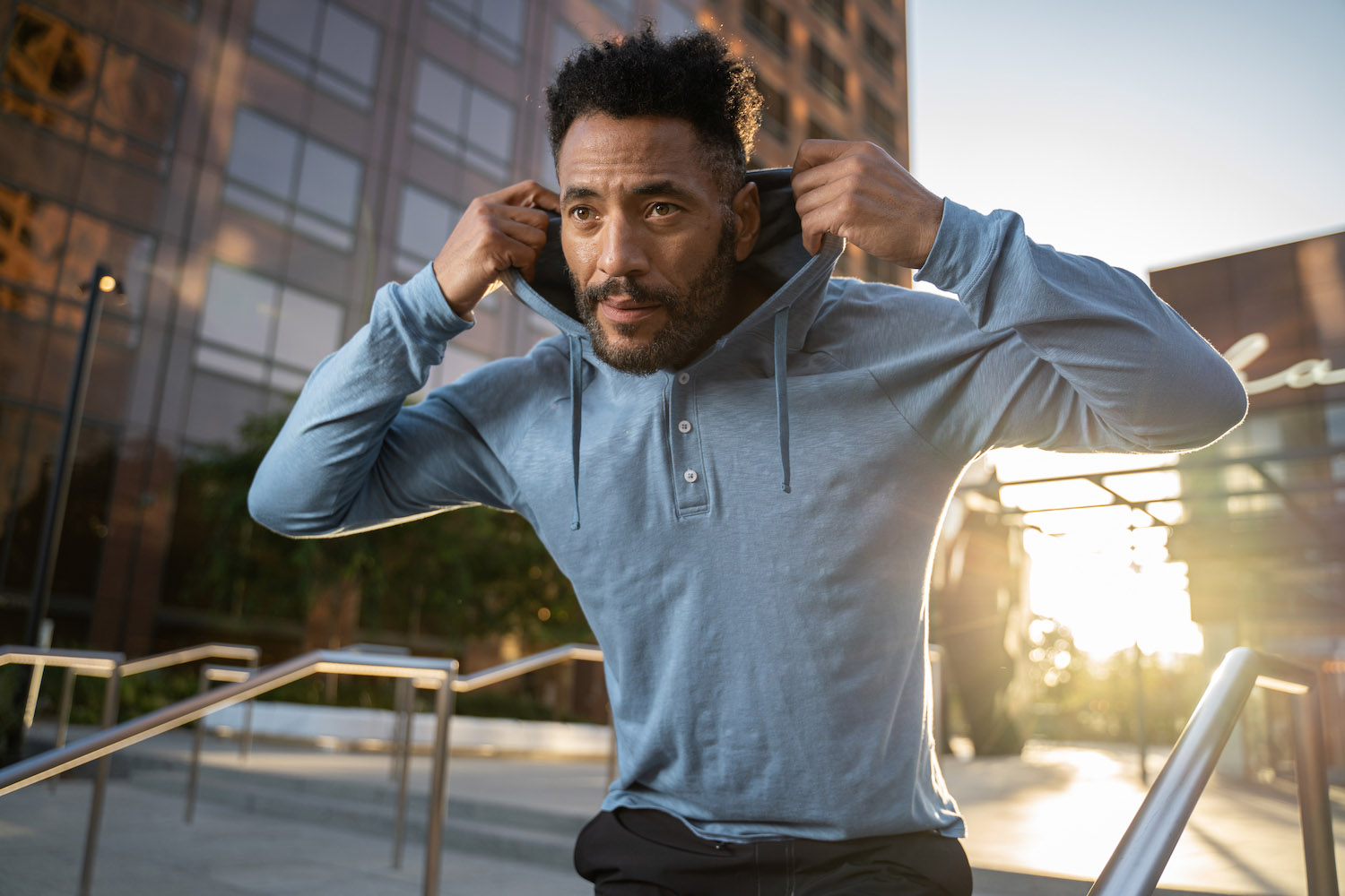 Lifestyle-On-Location-Model-Onmodel-Damion-Lloyd-Photography-Commercial-Product-Apparel-Clothing-Los-Angeles-Orange-County-male-man-GLYDER-sportswear-outdoor-city-blue-hoodie-sunset