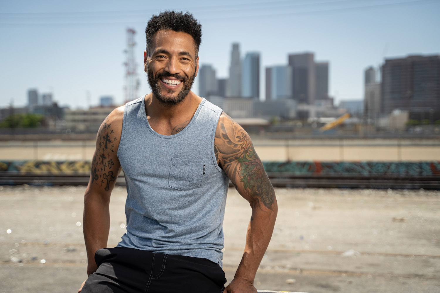 Lifestyle-On-Location-Model-Onmodel-Damion-Lloyd-Photography-Commercial-Product-Apparel-Clothing-Los-Angeles-Orange-County-male-man-GLYDER-sportswear-outdoor-city-blue-tank-menswear-smile-downtown