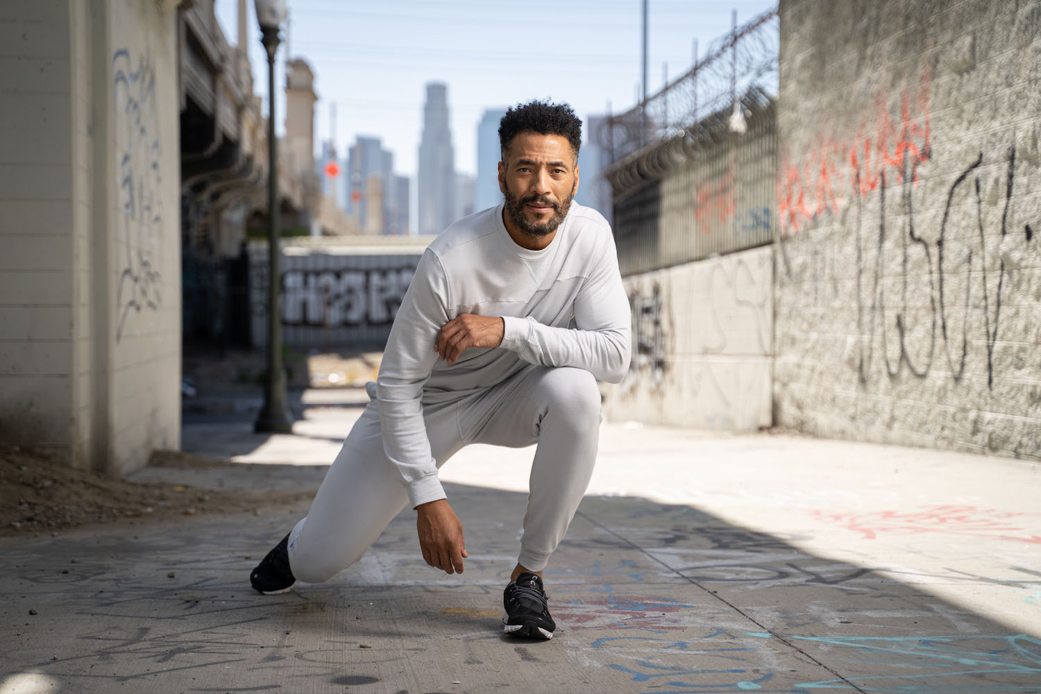 Lifestyle-On-Location-Model-Onmodel-Damion-Lloyd-Photography-Commercial-Product-Apparel-Clothing-Los-Angeles-Orange-County-male-man-GLYDER-sportswear-outdoor-city-kneel-alley-active-downtown