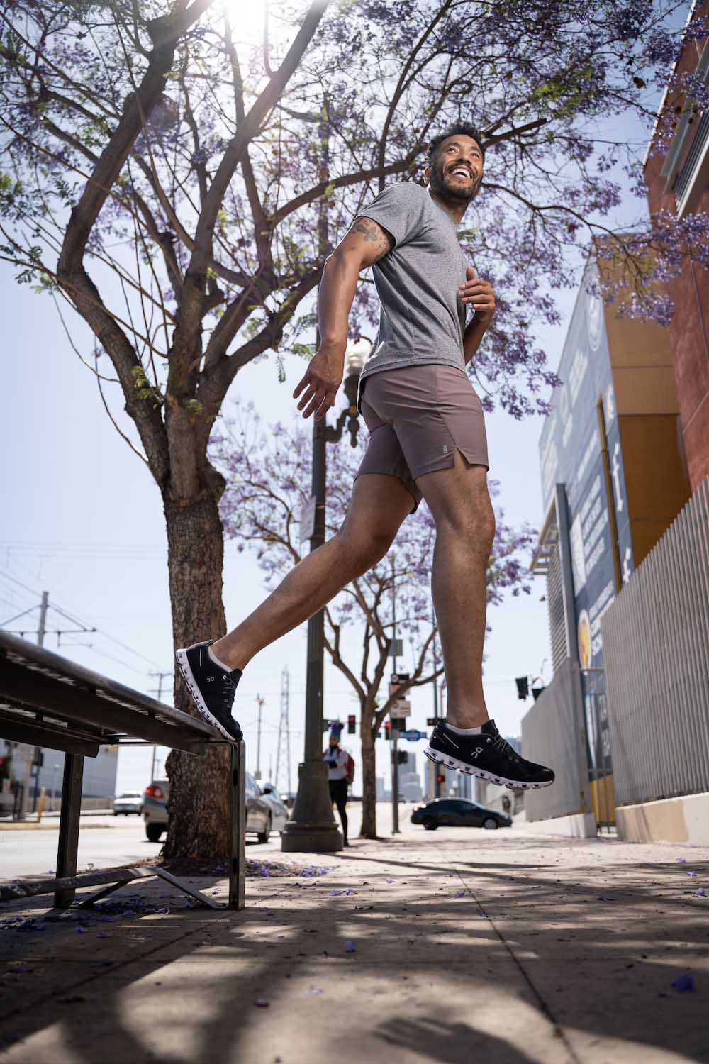 Lifestyle-On-Location-Model-Onmodel-Damion-Lloyd-Photography-Commercial-Product-Apparel-Clothing-Los-Angeles-Orange-County-male-man-GLYDER-sportswear-outdoor-city-sidwalk-smile-active-jump