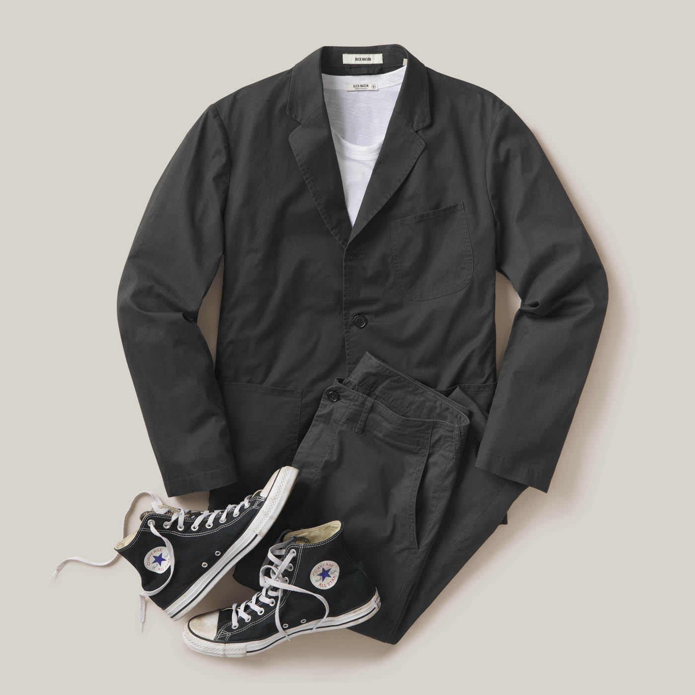 buck-mason-damion-lloyd-commercial-photography-product-clothing-editorial-overhead-pants-shirt-jacket-converse-outfit-black-jean-denim